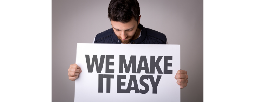 Man holding We Make It Easy Sign