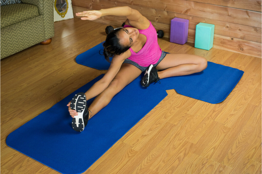 Girl on T-Fit Yoga Mat Stretching